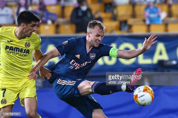 Arsenal's English defender Rob Holding vies for the ball with Villarreal's Spanish forward Gerard Moreno during the Europa League semi-final first...