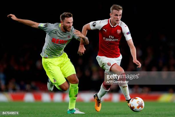 Arsenal's English defender Rob Holding vies with FC Cologne's German midfielder Marco Hoger during the UEFA Europa League Group H football match...