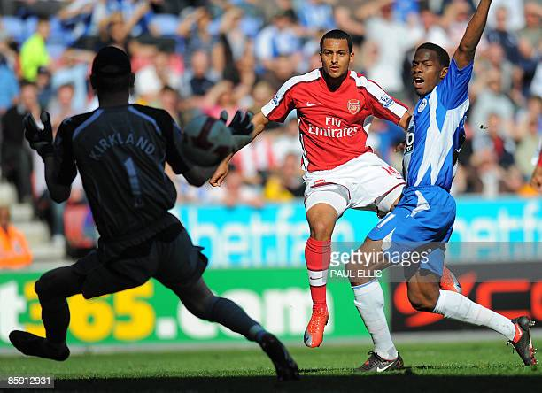 Arsenal's English forward Theo Walcott scores the equalizing goal past Chris Kirkland during their English Premier League football match against...