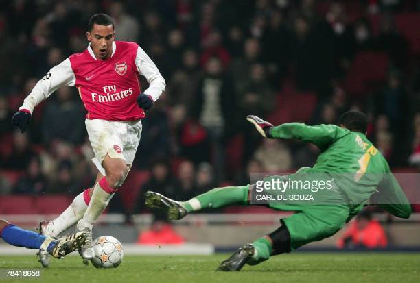 Arsenal's English forward Theo Walcott tries to shoot past Steua Bucharest's Goalkeeper Robinson Zapata during their Group H Champions League...
