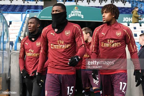Arsenal's English midfielder Ainsley MaitlandNiles and Arsenal's Nigerian striker Alex Iwobi prepare to warm up ahead of the English Premier League...