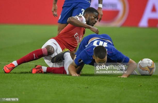 Arsenal's English midfielder Ainsley MaitlandNiles and Chelsea's Belgian midfielder Eden Hazard vie for the ball during the UEFA Europa League final...