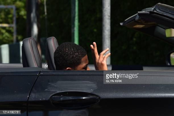 Arsenal's English midfielder Ainsley MaitlandNiles arrives at at Arsenal's Colney training centre north of London on May 20 2020 as training...