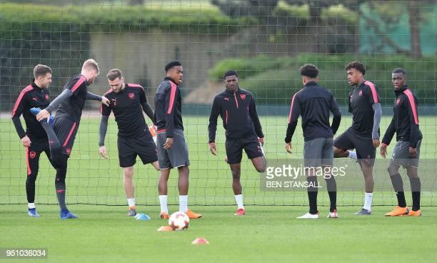 Arsenal's English midfielder Ainsley MaitlandNiles Arsenal's Nigerian striker Alex Iwobi and Arsenal's English striker Eddie Nketiah attends a...