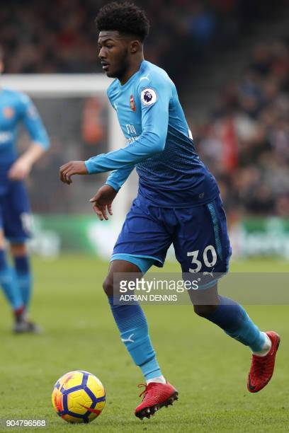 Arsenal's English midfielder Ainsley MaitlandNiles controls the ball during the English Premier League football match between Bournemouth and Arsenal...