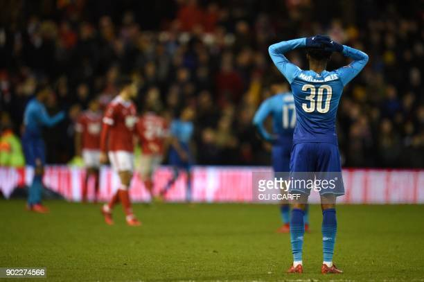 Arsenal's English midfielder Ainsley MaitlandNiles reacts after the English FA Cup third round football match between Nottingham Forest and Arsenal...