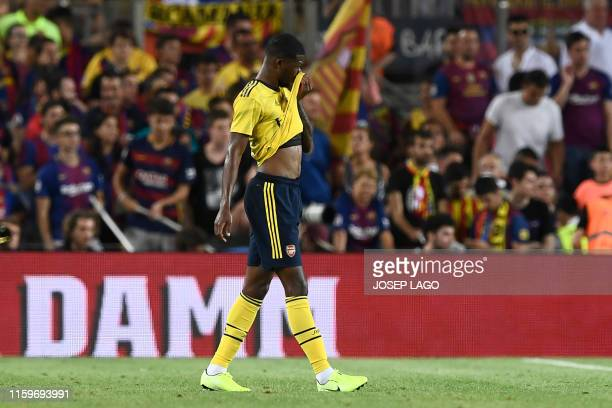 Arsenal's English midfielder Ainsley MaitlandNiles reacts to scoring an own goal during the 54th Joan Gamper Trophy friendly football match between...