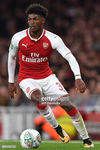 Arsenal's English midfielder Ainsley MaitlandNiles runs with the ball during the English League Cup third round football match between Arsenal and...