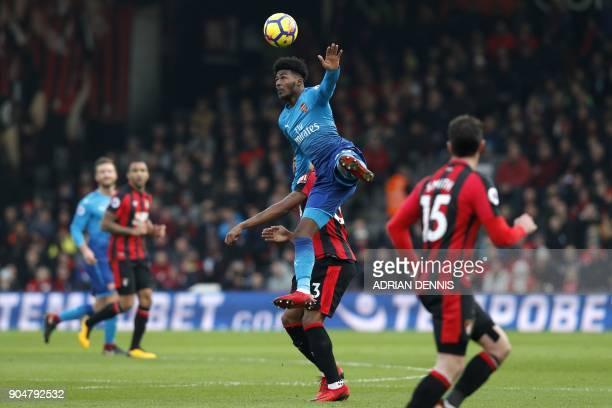 Arsenal's English midfielder Ainsley MaitlandNiles vies with Bournemouth's English midfielder Jordon Ibe during the English Premier League football...