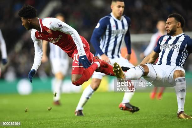 Arsenal's English midfielder Ainsley MaitlandNiles vies with West Bromwich Albion's Englishborn Scottish midfielder Matt Phillips during the English...
