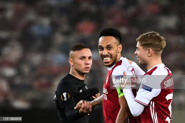 Arsenal's English midfielder Emile Smith Rowe and Arsenal's Gabonese striker Pierre-Emerick Aubameyang celebrate at the end of the UEFA Europa League...