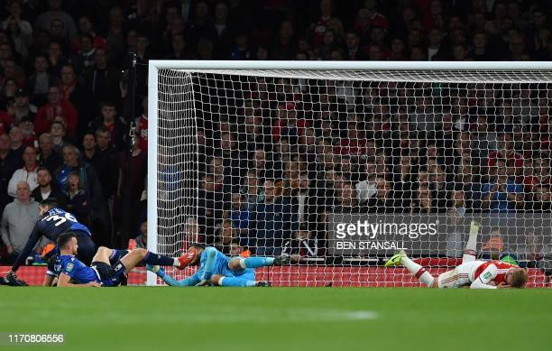 Arsenal's English midfielder Emile Smith Rowe lays on the pitch injured after clashing with Nottingham Forest's English defender Jack Robinson whilst...