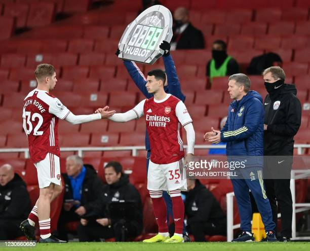 Arsenal's English midfielder Emile Smith Rowe leaves the pitch after being substituted off for Arsenal's Brazilian striker Gabriel Martinelli during...