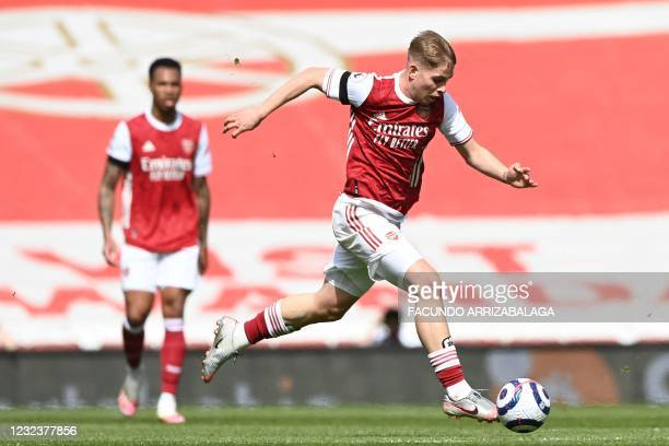 Arsenal's English midfielder Emile Smith Rowe runs with the ball during the English Premier League football match between Arsenal and Fulham at the...