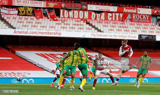 Arsenal's English midfielder Emile Smith Rowe shoots to score the opening goal during the English Premier League football match between Arsenal and...