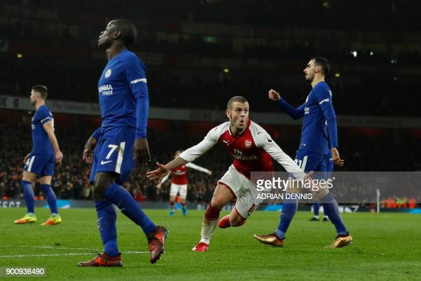 Arsenal's English midfielder Jack Wilshere celebrates after scoring during the English Premier League football match between Arsenal and Chelsea at...