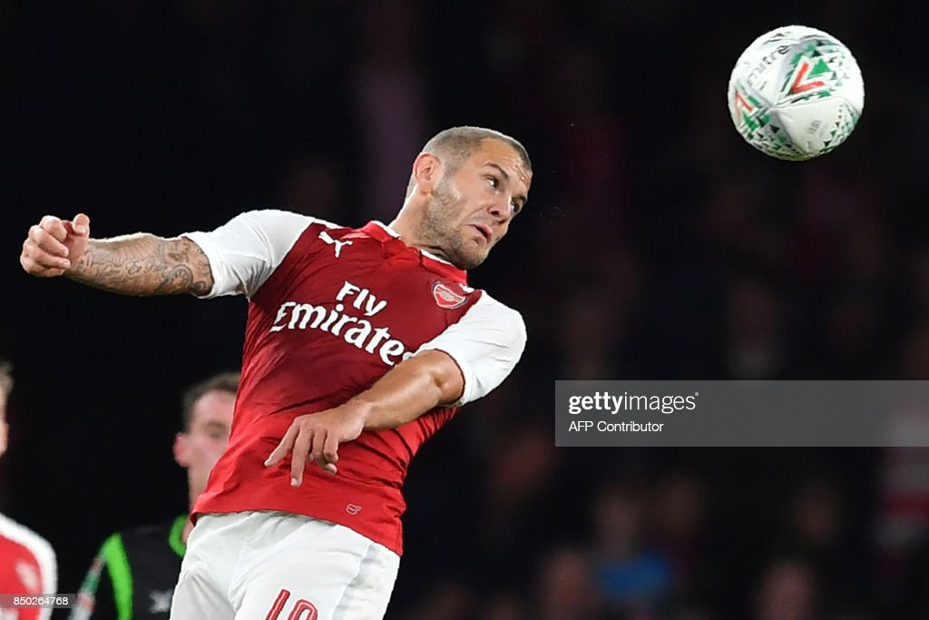 Arsenal's English midfielder Jack Wilshere heads the ball during the English League Cup third round football match between Arsenal and Doncaster Rovers at The Emirates Stadium in London on September 20, 2017. / AFP PHOTO / Ben STANSALL / RESTRICTED TO EDITORIAL USE. No use with unauthorized audio, video, data, fixture lists, club/league logos or 'live' services. Online in-match use limited to 75 images, no video emulation. No use in betting, games or single club/league/player publications. /