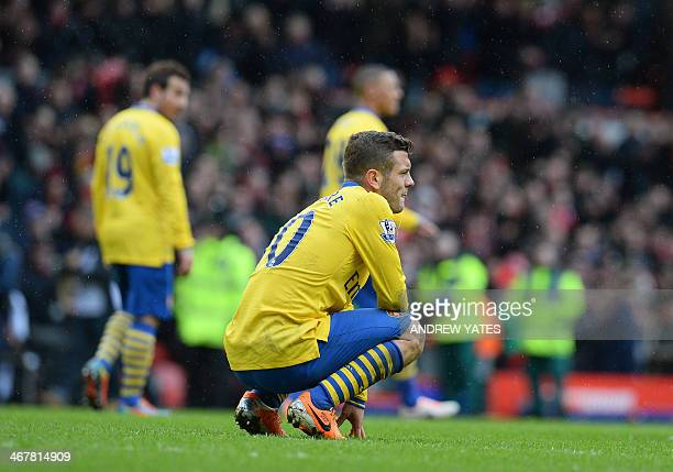 Arsenal's English midfielder Jack Wilshere reacts at the final whistle in the English Premier League football match between Liverpool and Arsenal at...