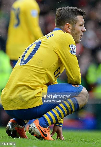 Arsenal's English midfielder Jack Wilshere reacts at the final whistle during the English Premier League football match between Liverpool and Arsenal...