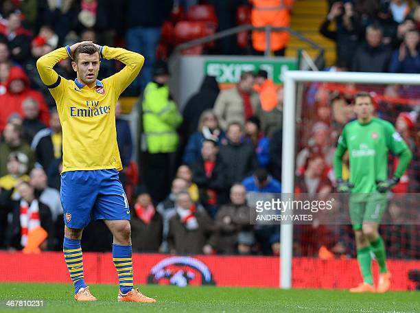 Arsenal's English midfielder Jack Wilshere reacts during the English Premier League football match between Liverpool and Arsenal at Anfield in...