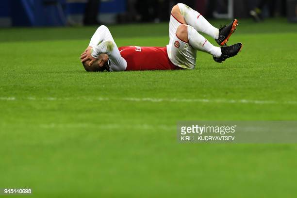 Arsenal's English midfielder Jack Wilshere reacts during the UEFA Europa League second leg quarterfinal football match between CSKA Moscow and...