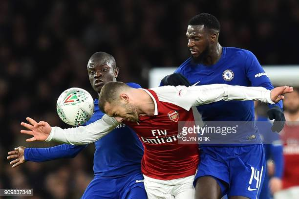 TOPSHOT Arsenal's English midfielder Jack Wilshere vies with Chelsea's French midfielder N'Golo Kante and Chelsea's French midfielder Tiemoue...