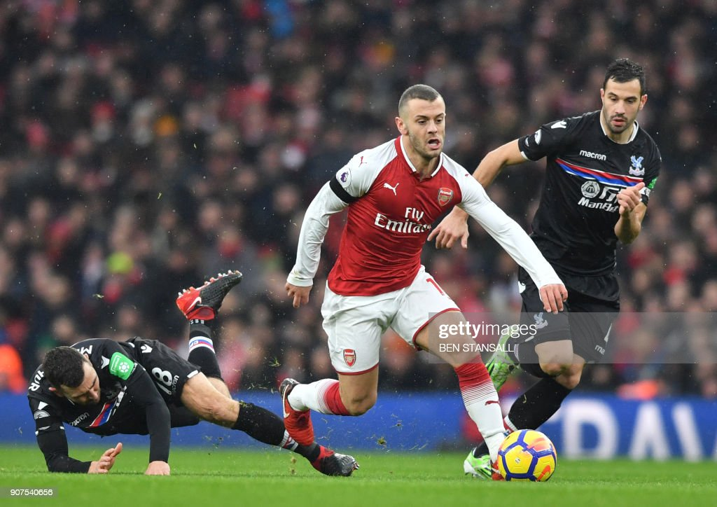 Arsenal's English midfielder Jack Wilshere (C) vies with Crystal Palace's Serbian midfielder Luka Milivojevic (R) during the English Premier League football match between Arsenal and Crystal Palace at the Emirates Stadium in London on January 20, 2018. / AFP PHOTO / Ben STANSALL / RESTRICTED TO EDITORIAL USE. No use with unauthorized audio, video, data, fixture lists, club/league logos or 'live' services. Online in-match use limited to 75 images, no video emulation. No use in betting, games or single club/league/player publications. /