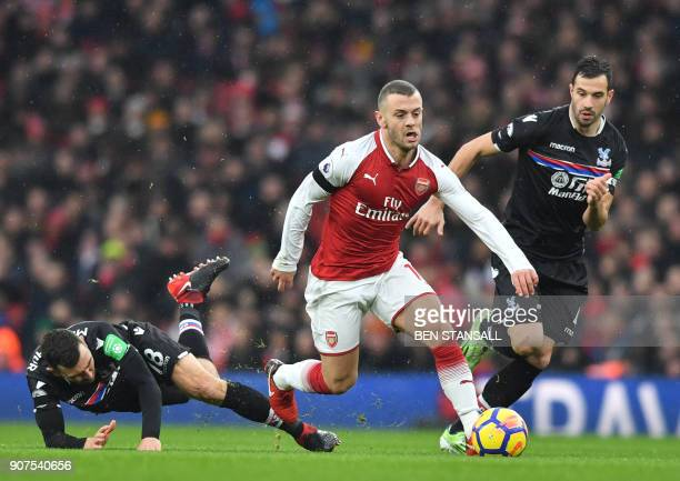 Arsenal's English midfielder Jack Wilshere vies with Crystal Palace's Serbian midfielder Luka Milivojevic during the English Premier League football...