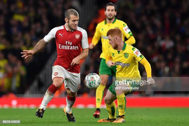 Arsenal's English midfielder Jack Wilshere vies with Norwich City's English midfielder Harrison Reed during the English League Cup fourth round...