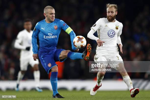 Arsenal's English midfielder Jack Wilshere vies with Ostersunds' English midfielder Curtis Edwards during the second leg of the Europa League Round...