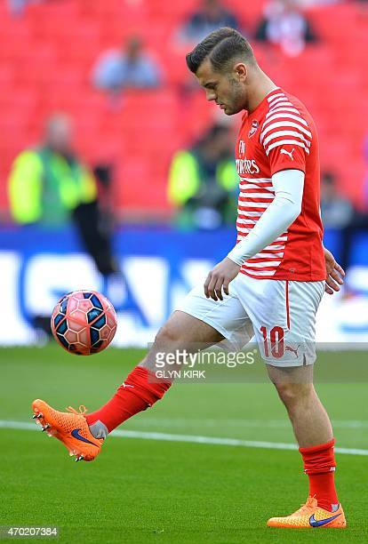 Arsenal's English midfielder Jack Wilshere warms up prior to the start of the FA Cup semi-final between Arsenal and Reading at Wembley stadium in...