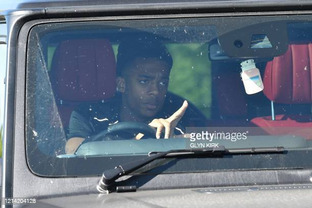 Arsenal's English midfielder Joe Willock arrives at Arsenal's Colney training centre north of London on May 20 2020 as training continues for Premier...