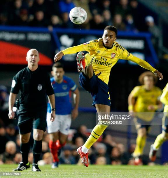 Arsenal's English midfielder Joe Willock controls the ball during the English FA Cup fifth round football match between Portsmouth and Arsenal at...