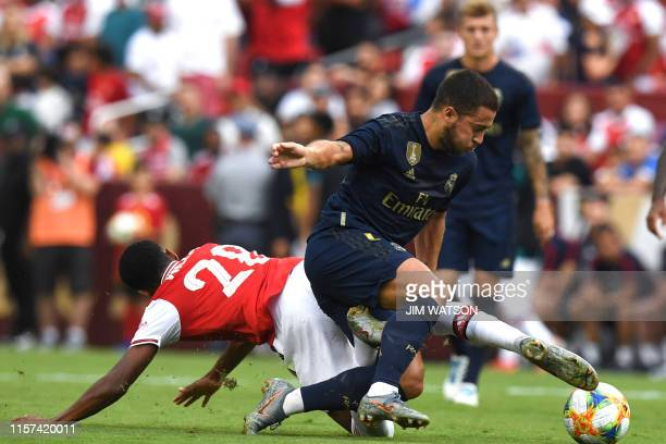 Arsenal's English midfielder Joe Willock fights for the ball with Real Madrid's Spanish defender Dani Carvajal during the International Champions Cup...