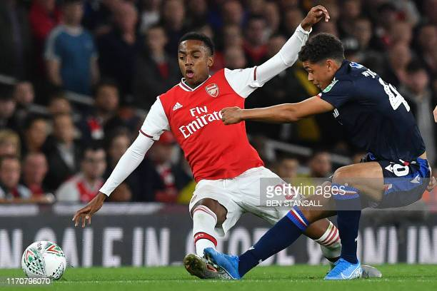 Arsenal's English midfielder Joe Willock vies with Nottingham Forest's Englishborn Welsh midfielder Brennan Johnson during the English League Cup...