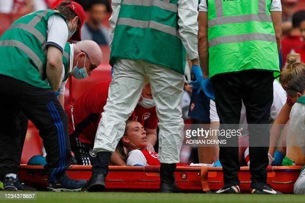 Arsenal's English midfielder Jordan Nobbs receives medical attention after picking up an injury during the pre-season friendly women's football match...