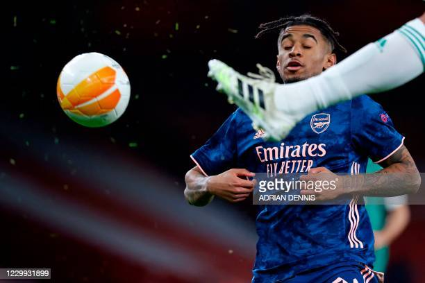 Arsenal's English midfielder Reiss Nelson avoids a high boot during the UEFA Europa League 1st Round Group B football match between Arsenal and Rapid...