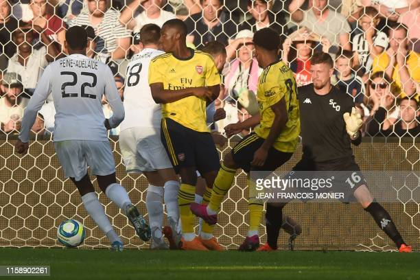 Arsenal's English midfielder Reiss Nelson scores past Angers' French goalkeeper Ludovic Butelle during the International friendly football match...