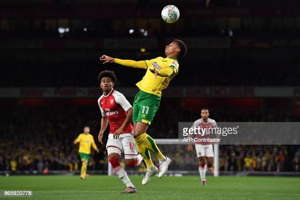 Arsenal's English midfielder Reiss Nelson vies with Norwich City's English midfielder Josh Murphy during the English League Cup fourth round football...