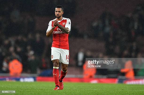 Arsenal's English midfielder Theo Walcott applauds the fans after the English Premier League football match between Arsenal and Stoke City at the...