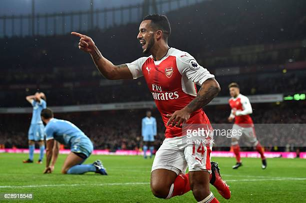 Arsenal's English midfielder Theo Walcott celebrates after scoring during the English Premier League football match between Arsenal and Stoke City at...