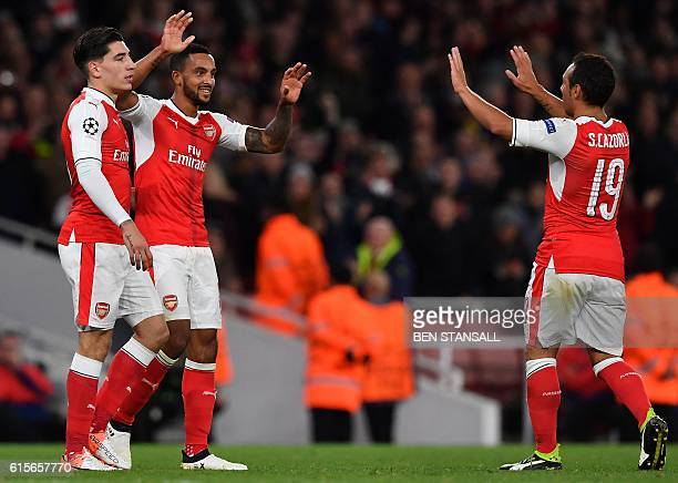Arsenal's English midfielder Theo Walcott celebrates scoring his team's second goal with Arsenal's Spanish defender Hector Bellerin and Arsenal's...