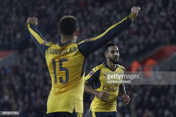 Arsenal's English midfielder Theo Walcott celebrates scoring his team's fourth goal with Arsenal's English midfielder Alex OxladeChamberlain during...