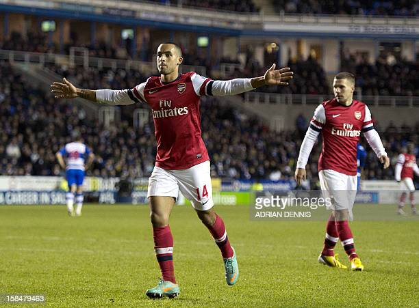 Arsenal's English midfielder Theo Walcott celebrates scoring their fifth goal against Reading during the English Premier League football match...