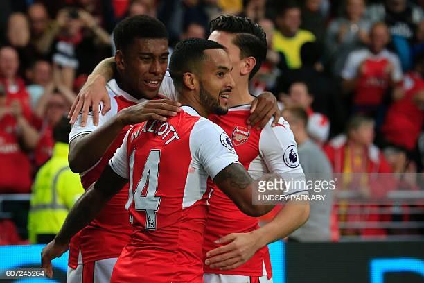 Arsenal's English midfielder Theo Walcott celebrates with Arsenal's Nigerian striker Alex Iwobi and Arsenal's Spanish defender Hector Bellerin after...