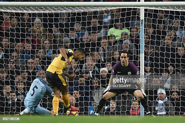 Arsenal's English midfielder Theo Walcott scores his team's first goal past Manchester City's Chilean goalkeeper Claudio Bravo during the English...