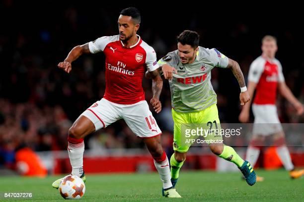 Arsenal's English midfielder Theo Walcott vies with FC Cologne's German midfielder Leonardo Bittencourt during the UEFA Europa League Group H...