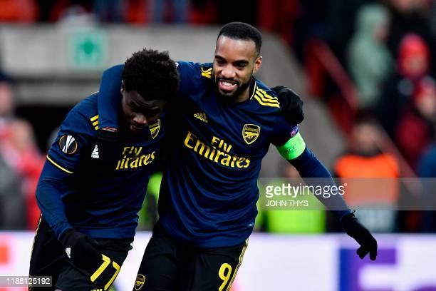 Arsenal's English striker Bukayo Saka celebrates with Arsenal's French striker Alexandre Lacazette after scoring during the UEFA Europa League Group...