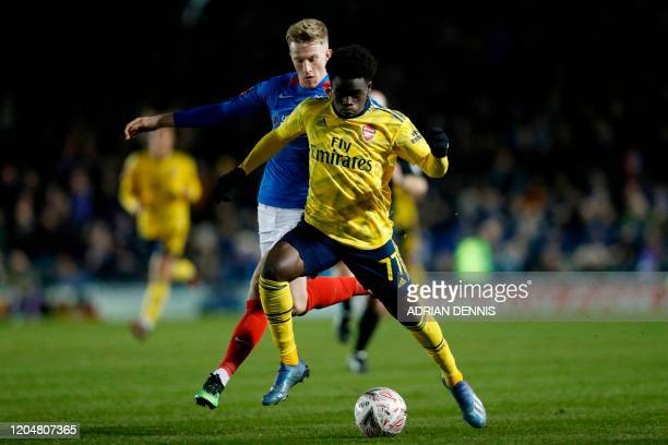 Arsenal's English striker Bukayo Saka runs with the ball during the English FA Cup fifth round football match between Portsmouth and Arsenal at...