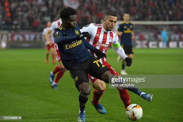 Arsenal's English striker Bukayo Saka vies with Olympiakos' Norwegian defender Omar Elabdellaoui during the UEFA Europa League round of 32 first leg...